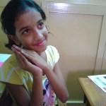 Sanjana posing for her Girl admiring Painting