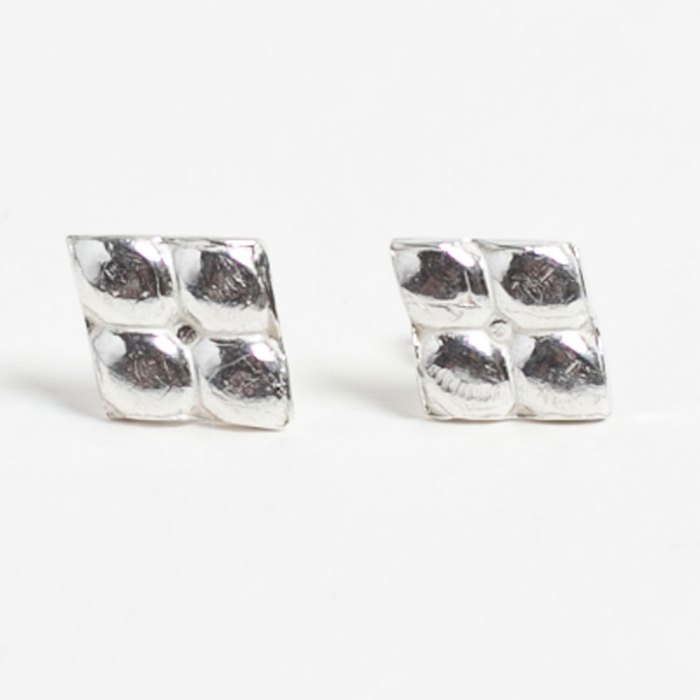 a pair of Jija studs, with a reptile texture. sterling silver