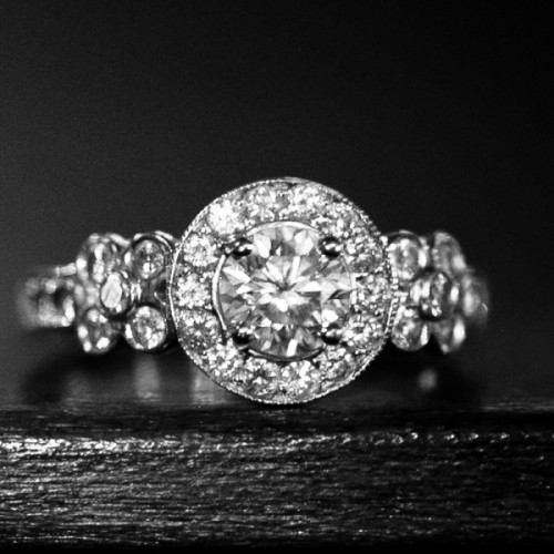 Custom designed, white gold engagement ring with 41 white diamonds