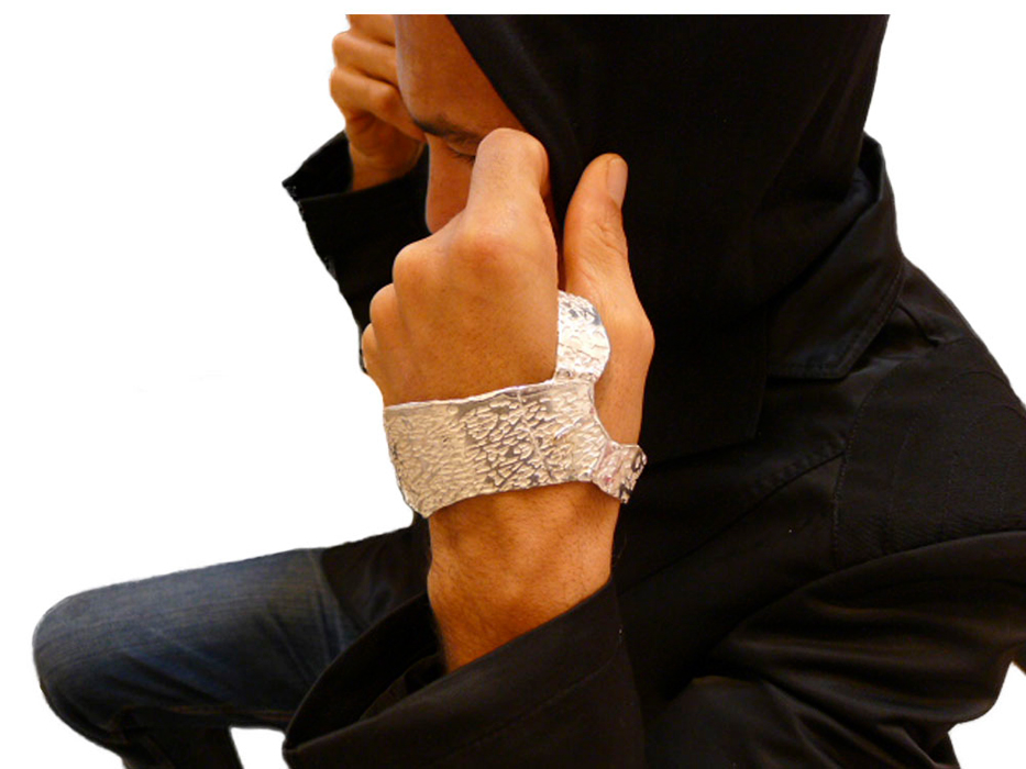 Male model wearing a sterling silver hand cuff