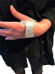 women model wearing a sterling silver Hand Cuff