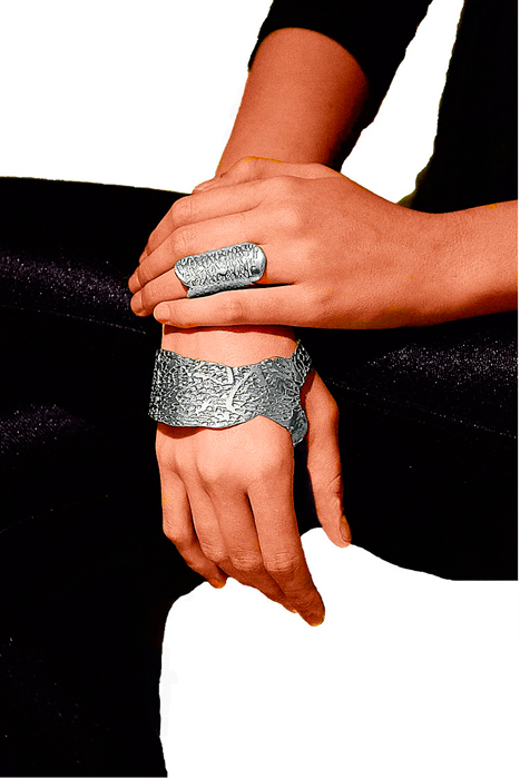 Model wearing a sterling silver Hand Cuff and a sterling silver Thuluth ring
