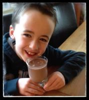 Ruairi drinking hot choc