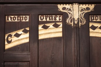 Dark wooden door with golden decorations and Hebrew language