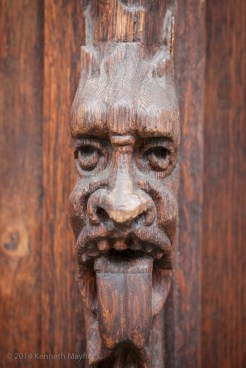 Close-up of a carved wooden devil's face