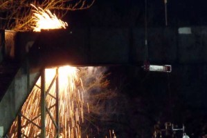 Showers of sparks as the old bridge is dismantled