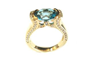final21 e1520552697278 - Half-Bezel Blue Topaz Diamond Ring