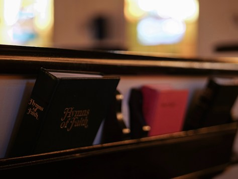 Bible and Hymnal in Church Pew