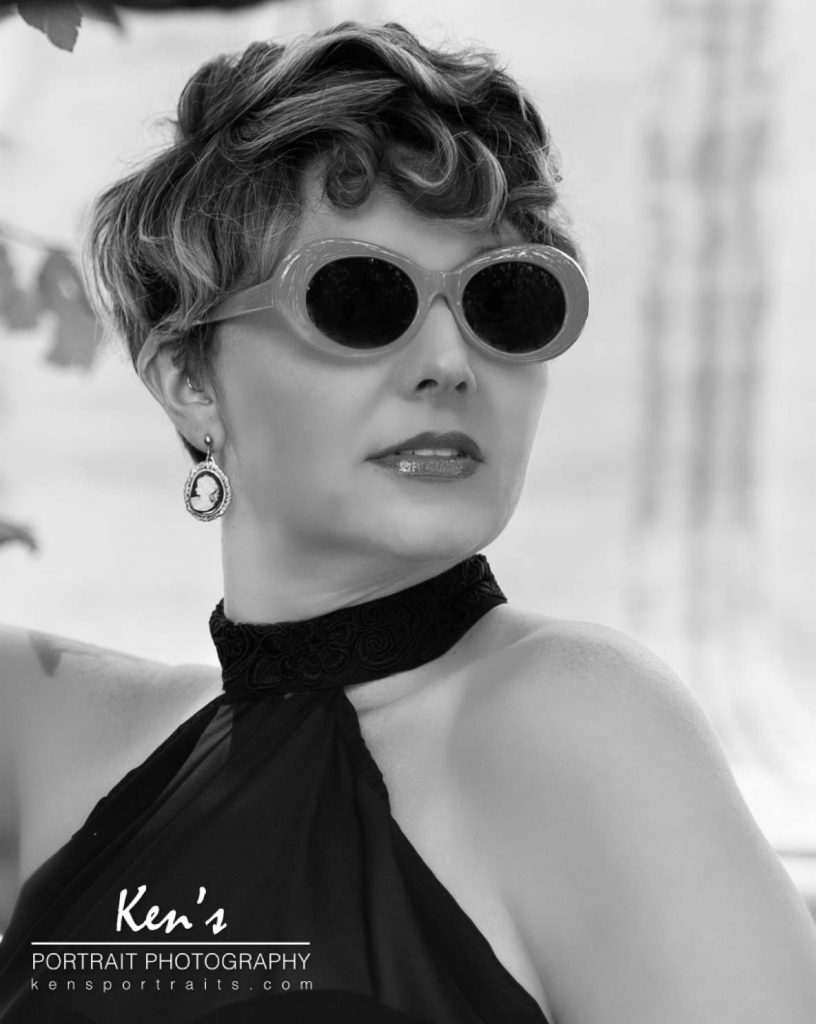 This image shows off the versatilityof Lori's look. Jill's makeup and hair styling, combined with the wardrobe selection, and the retro looking sunglasses, gives Lori a 1950ish movie star look.