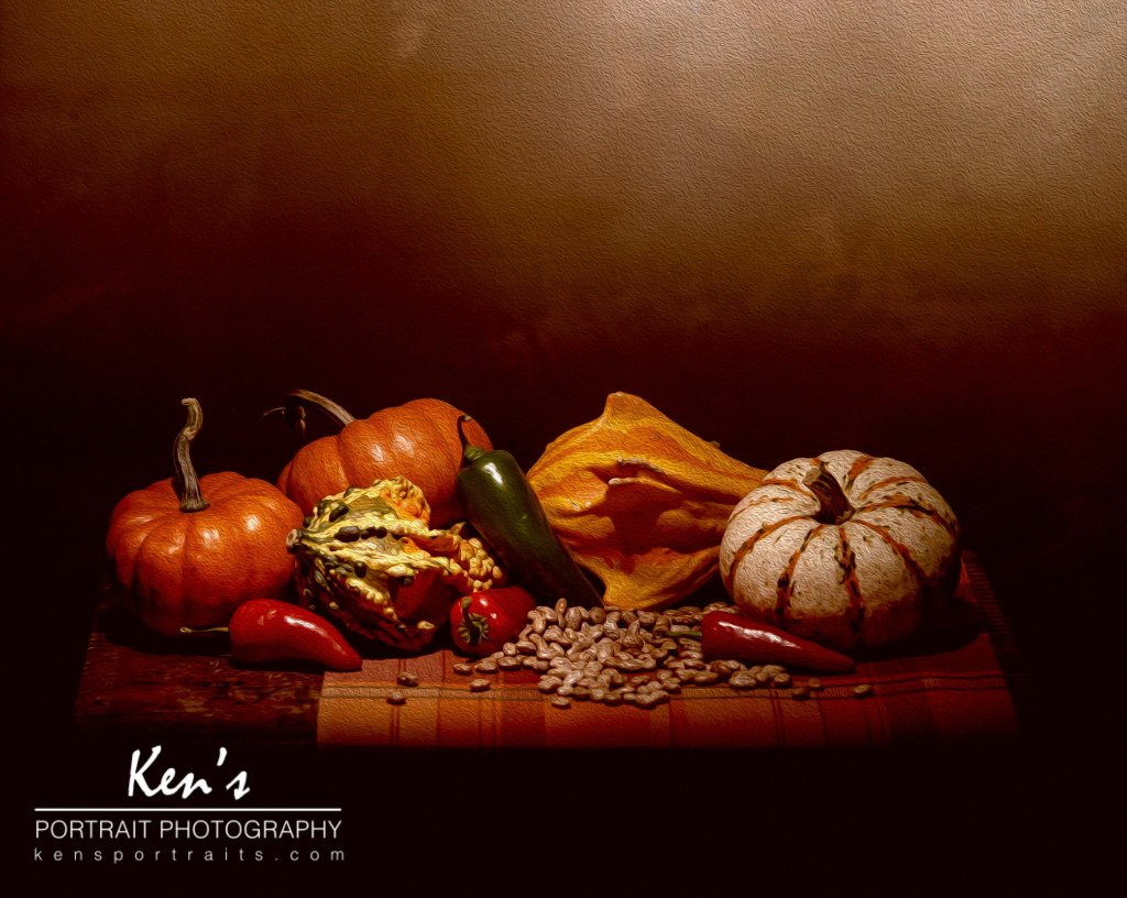 I was in the studio this weekend working on some food photography images. One of the photos I took was a still life image of some fall vegetables. I had a variety of pumpkins, gourds, peppers, and beans. The way the fall food colors complemented the browns of the backdrop gave this image a still life painting look and feel. By adding some brush strokes in post-processing, the photo was transformed into fine art still life portrait.