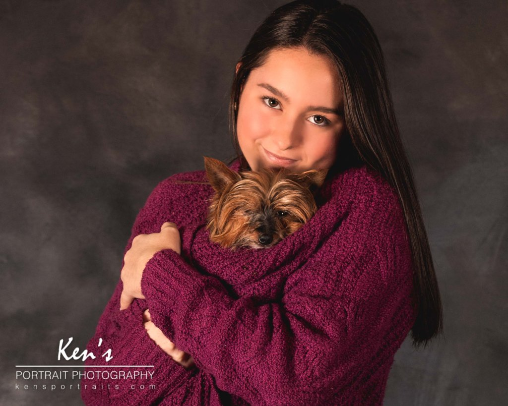 A True Friend Leaves Paw Prints on Your Heart by Kens Portrait Photography. One look at these two and you just know that they are best friends. Her furry terrier friend is warmly cuddled inside her sweater.