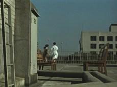 "Women taking a work-break in Ozu's film ""Late Autumn"" (1960). Advertising balloons float in the distance."
