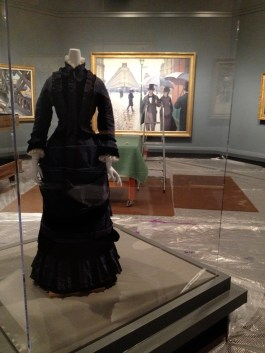 "Our dress (KSUM 1983.1.126ab) has a place of honor in this exhibition, right in front of Caillebotte's ""Paris Street; Rainy Day"""