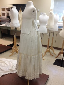 The form is first dressed with petticoats to fill out the dress appropriately.