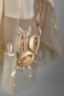 Detail at hem showing ribbonwork on wedding dress, KSUM 1983.1.309.
