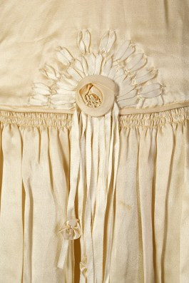 Waist detail showing ribbonwork on wedding dress, KSUM 1983.1.309.