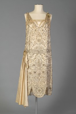 Front view of silk satin wedding dress shown without the train, KSUM 1983.1.334.