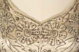 Detail of neckline on beaded evening dress of cream satin and chiffon, American, late 1920s, KSUM 1983.1.341.