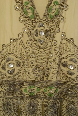 Detail of beading on green silk chiffon dress, KSUM 1996.58.343