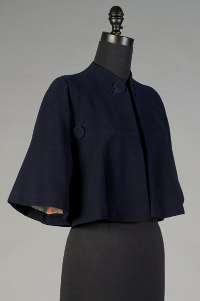 Navy blue wool cape, Pauline Trigère, 1941. KSUM 2003.6.4 ab.