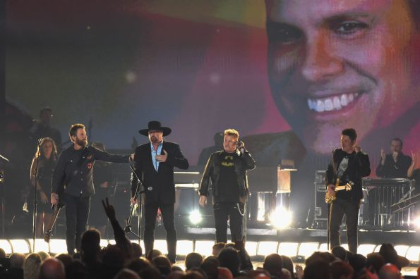 """Dierks Bentley, Eddie Montgomery, and Rascal Flatts perform """"My Town"""" in honor of Troy Gentry at """"The 51st Annual CMA Awards."""" Photo by Rick Diamond/Getty Images"""