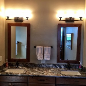 Granite and hardwood custom bathroom