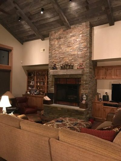barnwood ceiling fireplace living room custom montana home