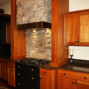 Chef's kitchen with stone features