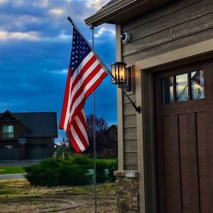 God Bless America Montana custom home garage stonework