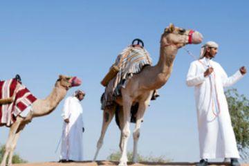 Taking a camel ride at Banyan Tree Al Wadi