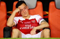 Mesut Ozil left out of Arsenal squad
