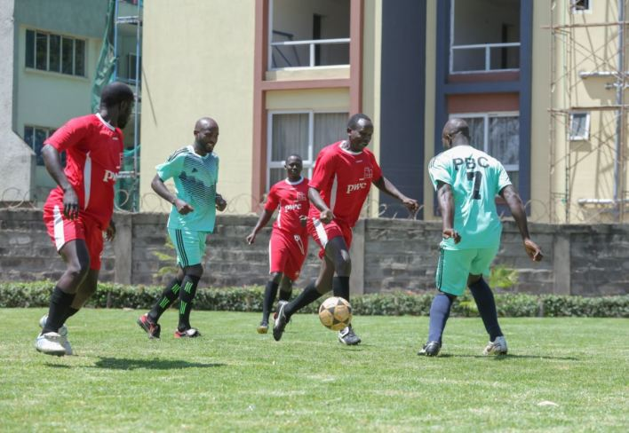 Parklands Baptist Church playing a friendly match against PwC football team on the football pitch commissioned at the church grounds