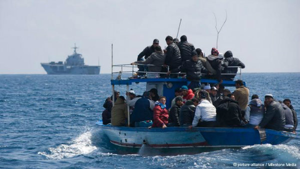 Migrants on board boat off the coast of Lampedusa