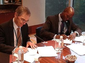 Capital Markets Authority Chief Executive, Mr. Paul Muthaura (Right) and his Australian counterpart sign an agreement to support Fintech innovations