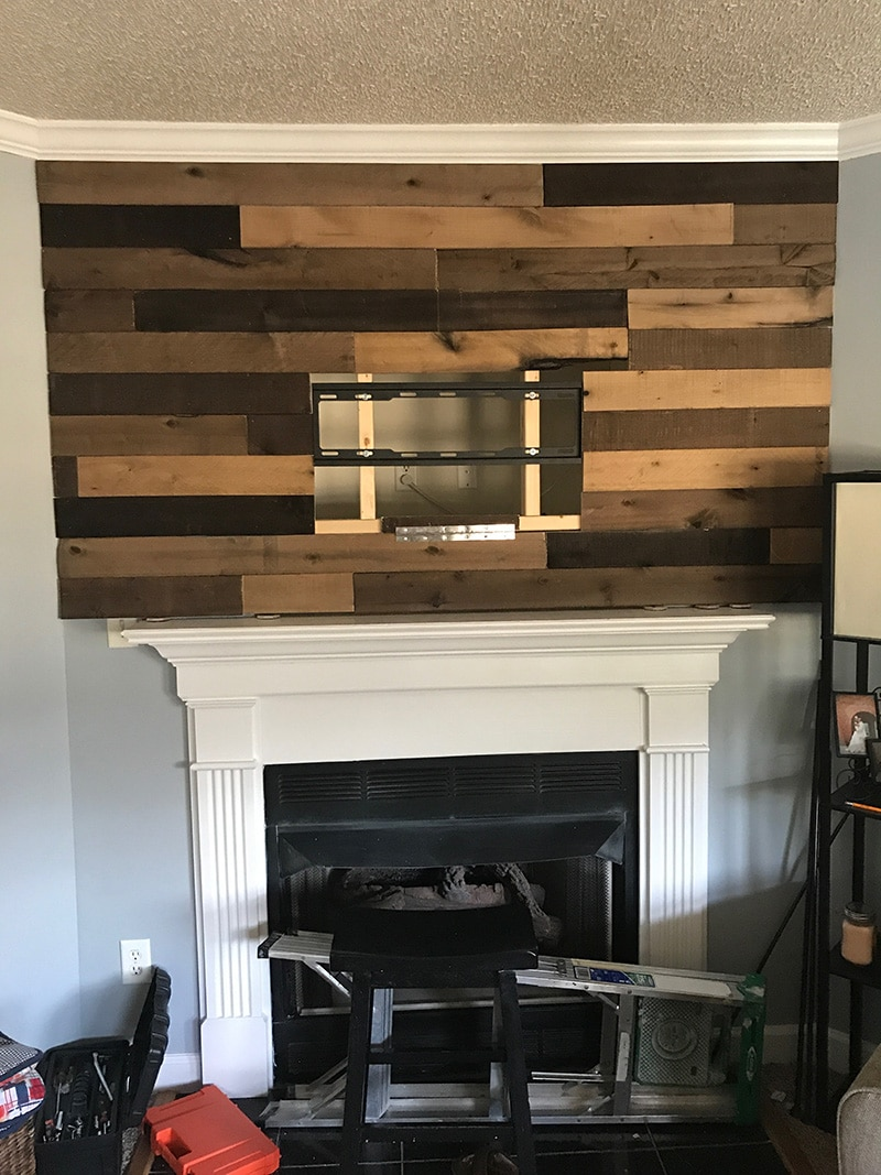 wood planked wall before handles added and TV mounted