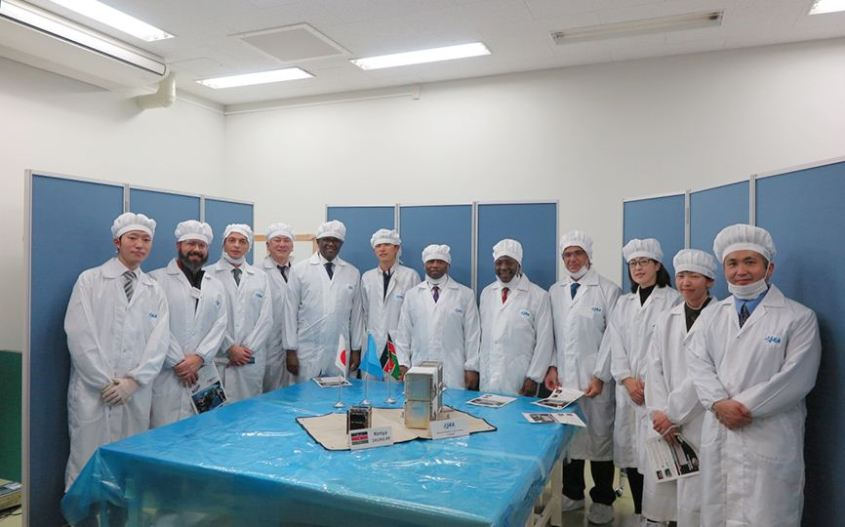 University of Nairobi handing over its Cubesat satellite to JAXA