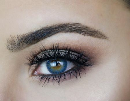 Close-up photo of an eye and an eyebrow