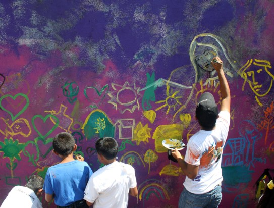 100 creative kids and lots of walls to paint
