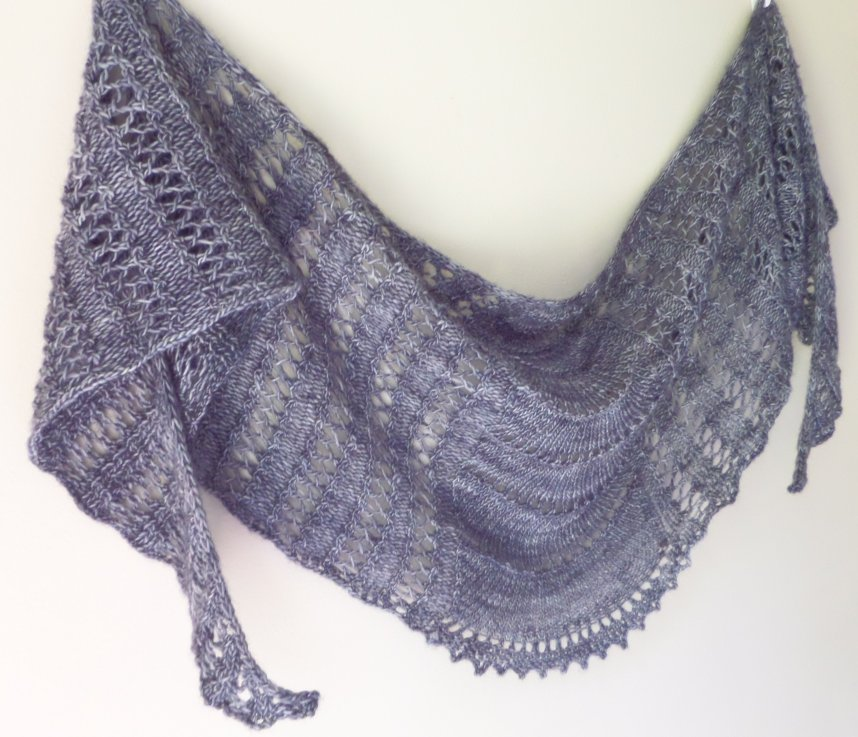 A top-down crescent shawl with lace patterning on every row.