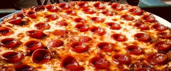 Enjoy a pizza while you watch the game at Kep's Sports Bar & Grill