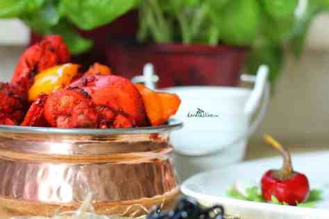Basil Chicken Tikka Masala - A succulent red creamy chicken with the perfect blend of spices and flavors.