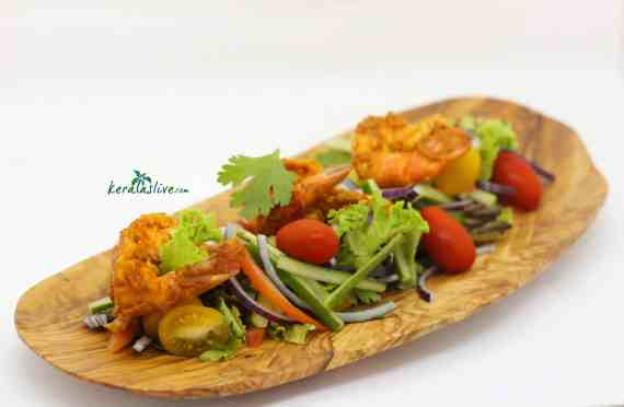 Ajowan prawn salad - This simple prawn salad takes only a few minutes to pull together, looks fantastic and tastes delicious. It's all down to the tasty Indian flavours of ajowan seeds, turmeric, garam masala and mango pickle.