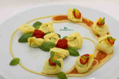 Ricotta spinach tortellini with Makhani sauce - Shapes of some food items are great, especially pastas. Pastas like tortellini, ravioli, fusilli, farfalle are great in plate presentations. Here I have used ricotta spinach tortellini with makhani sauce. Makhani sauce is one of the favourites' among Indian sauces. It is a delicately flavoured sauce which has a taste of tomatoes, aromatic spices, butter and cream...