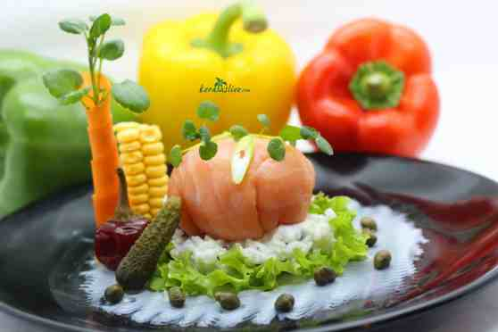 Smoked salmon with Curd rice. Thayir sadam- is popular among south Indians as a part of meal. Rice and yogurt are the main ingredients. Here its a fusion of smoked salmon, capers, gherkins and onion.