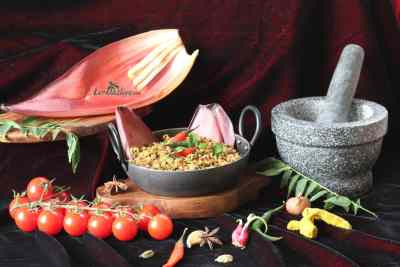Banana blossom Stir Fry / Vazha koombu thoran - Purple in colour, heart – shaped, it is commonly seen in Indian groceries where it is considered as a vegetable. It's a very good source of fibre and many medicinal values.