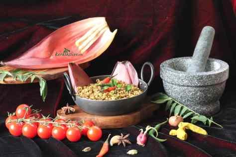 Banana blossom Stir Fry / Vazha koombu thoran - Have you ever tried cooking a banana flower or a banana blossom? Purple in colour, heart – shaped, it is commonly seen in Indian groceries where it is considered as a vegetable. It's a very good source of fibre and many medicinal values.