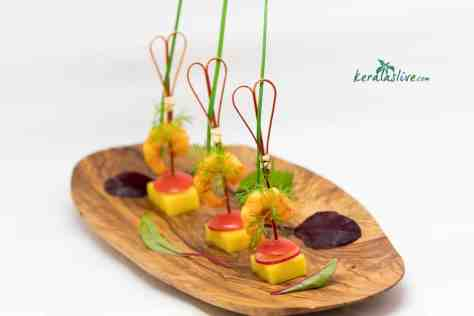 Spicy king prawns with Alphonso mangoes. An amazing sweet and spicy combination which can served as a hors d'oeuvres.
