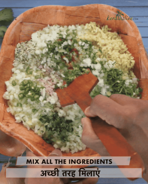 mixing the ingredients for ulli vada