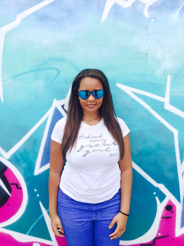 Beautiful girl in Abercrombie and Fitch against Wynwood walls street art wearing Wildfox heart sunglasses festival style