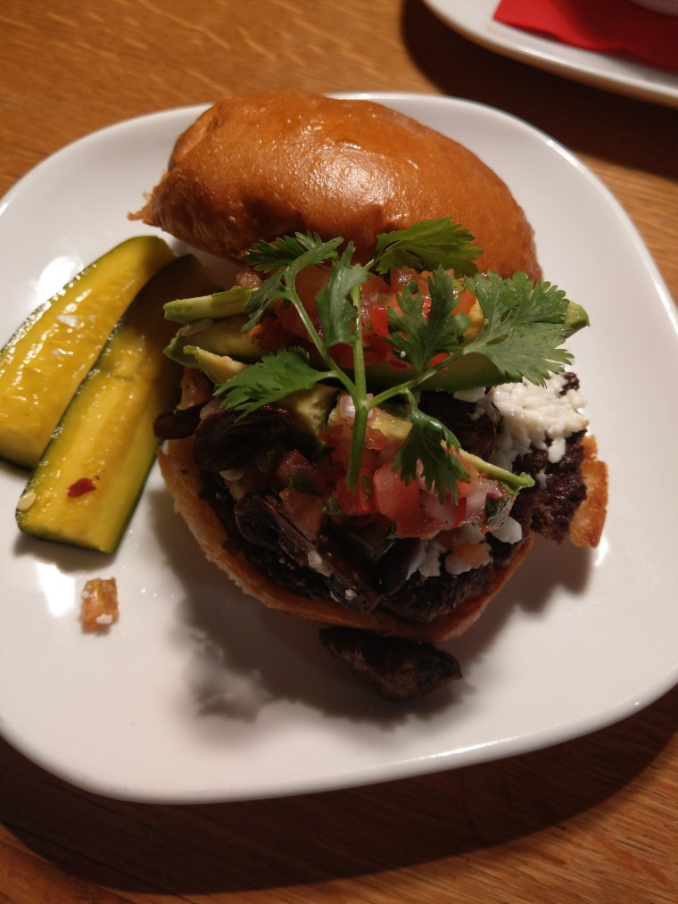 Flip burger Angus beef guacamole with diced tomatoes, cilantro and cheese